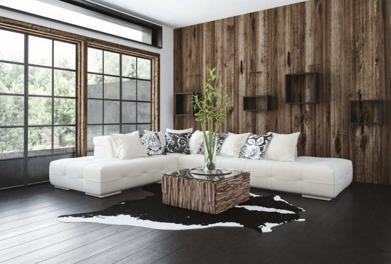Stylish rustic living room with wood paneling on the wall and wi